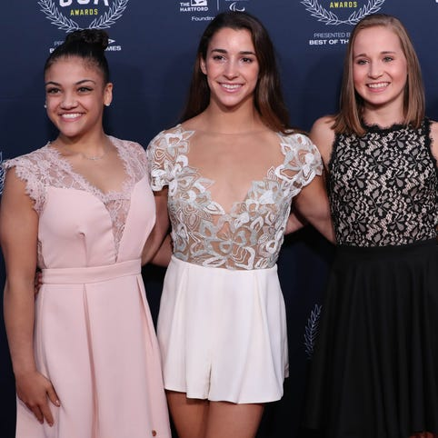 Olympic gymnasts (left to right) Laurie Hernandez, Aly Raisman, Madison Kocian and Simone Biles walk the red carpet at the Team USA Awards held at Georgetown University on Sept. 28.