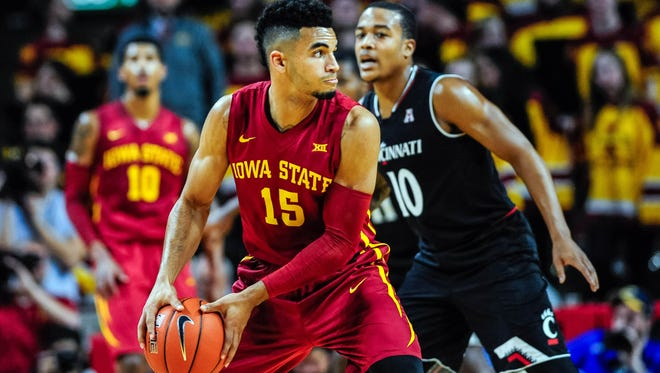 Iowa State Cyclones guard Nazareth Mitrou-Long (15) is defended by Cincinnati Bearcats guard Troy Caupain (10) during the first half at James H. Hilton Coliseum.