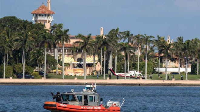 Trump's personal helicopter lands at the new helipad at Mar-a-Lago in Palm Beach on April 8.