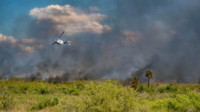 The Florida Forest Service uses a helicopter to drop slow burning devices to start a 5,000-acre controlled burn in 2019 hoping to reduce the amount of available fuel in the marsh on the west side of Lake Okeechobee.
