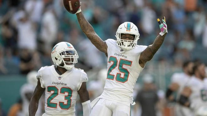 Dolphins cornerback Xavien Howard celebrates a fumble recovery in 2018.