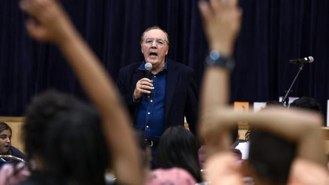 James Patterson takes questions from students during an appearance at a local school in 2018. The Palm Beach resident will be at the March 2 Culture & Cocktails event.