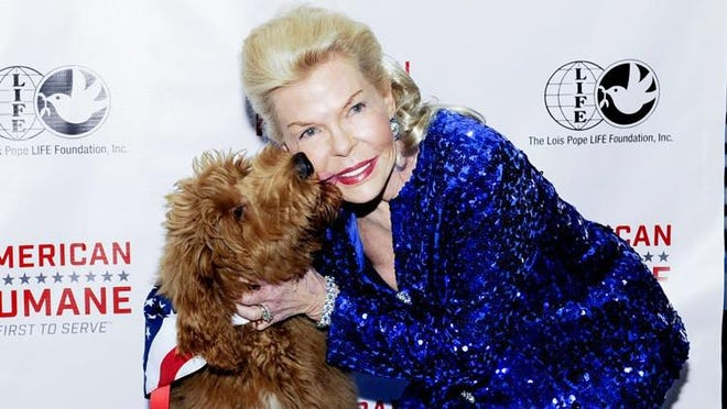 Lois Pope with Patton at American Humane Association's 2017  Celebration of Military War Dogs reception at The Brazilian Court