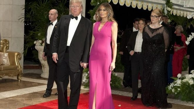 President Donald Trump and Melania Trump arrive at the Diamond Centennial Red Cross Ball at The Mar-a-Lago Club in 2017.