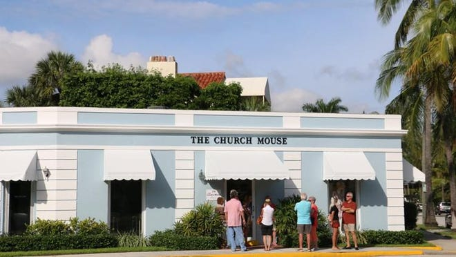Shoppers wait outside of the Church Mouse in 2019.