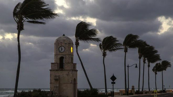 Windy weather shortly before dawn at the Worth Avenue Clocktower on Palm Beach Friday, January 26, 2018.