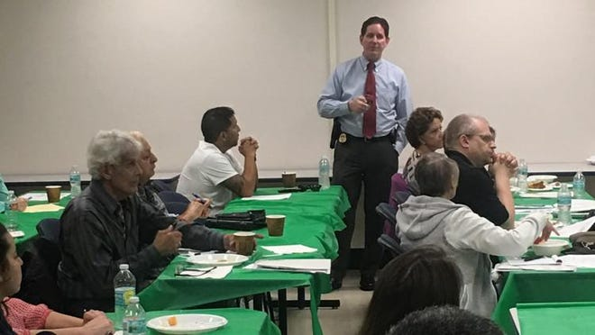 Palm Beach County Sheriff's Detective John Cogburn addresses a Citizen's Justice Academy class. County residents who want to learn more about the criminal justice system can sign up for classes from 6 to 9 p.m. beginning Feb. 3.