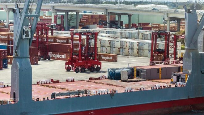 Containers from Tropical Shipping are offloaded from a ship at the Port of Palm Beach in Riviera Beach in April 2017. The port's largest tenant, Tropical Shipping, started in 1963.