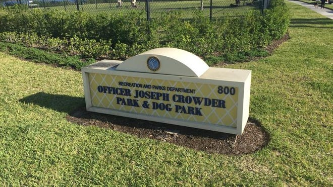 A sign at the dog park honoring Officer Joseph Crowder.