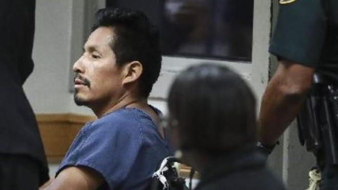 Genaro De La Cruz Ajqui is being held at Palm Beach County Jail without bond.