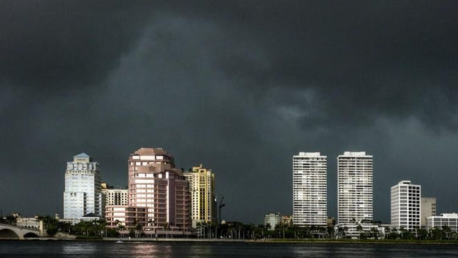 A storm rolls in over West Palm Beach Friday afternoon, June 8, 2018.