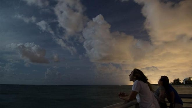 Jonathan Frank, 17, Lake Worth, is lit by the brightness of the Harvest moon.