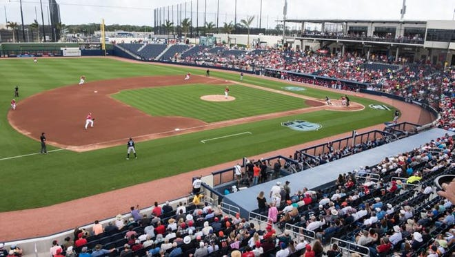 Baseball fans gather at The Ballpark of the Palm Beaches to watch a spring training matchup with the Washington Nationals and the Houston Astros in  2017.