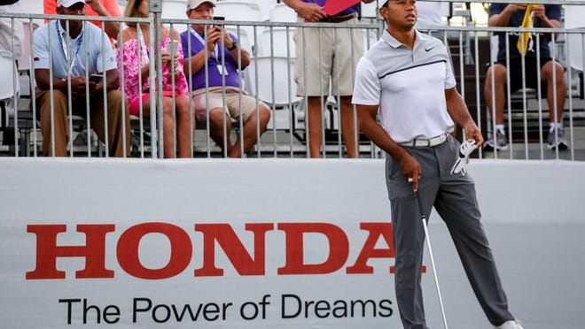 Tiger Woods prepares to drive from the first tee during the Honda Classic Pro-Am at PGA National in Palm Beach Gardens on February 21, 2018.