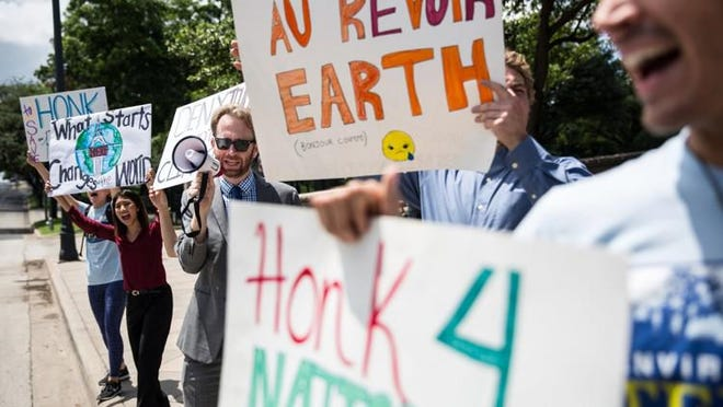 Activists from Environment Texas gather outside of the Capitol to protest President Donald Trump?s decision to pull the U.S. from the Paris climate agreement on June 1, 2017.