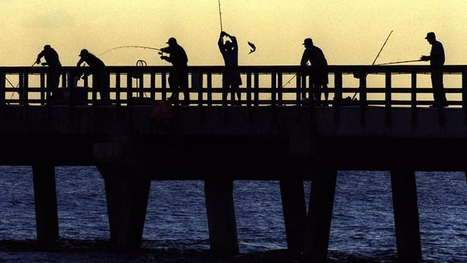 Anglers line the Lake Worth Pier.