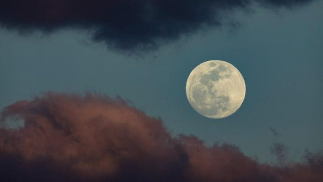 The super moon rises in the sky in Palm Beach, January 30, 2018.