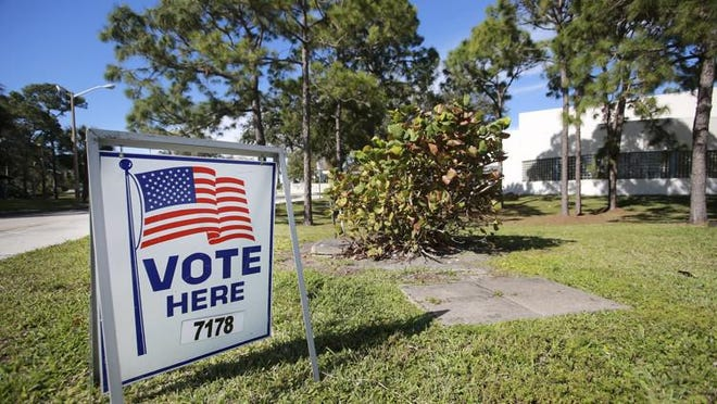 """A """"Vote Here"""" sign stands outside the Ezell Hester Jr. Community Center in Boynton Beach Tuesday, January 30, 2018."""