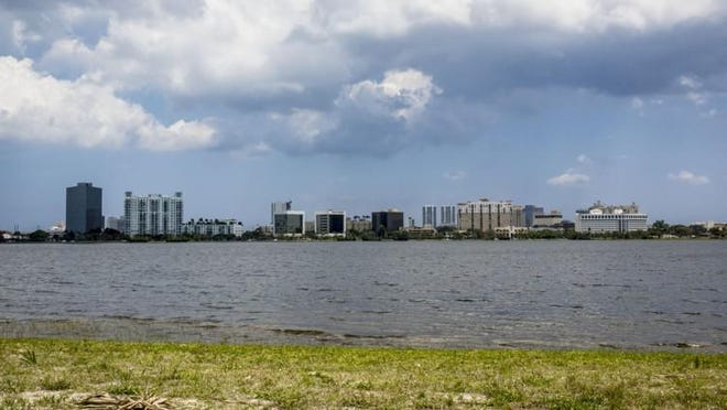 A view of downtown West Palm Beach across Clear Lake, north of Okeechobee Boulevard. Sewage spilled from a broken main 985 feet from the reservoir but officials said drinking water wasn't affected.