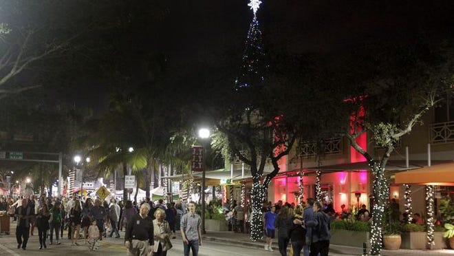 Crowds ring in the new year during Delray Beach's First Night 2013. The city is restricting restaurant and bar hours and gatherings of 10 or more people beginning Tuesday due to the coronavirus outbreak.
