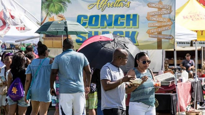 Vendors at the Royal Palm Beach Seafood Festival serve a range of seafood dishes. The event also includes live music and vendors selling nautical-themed items.