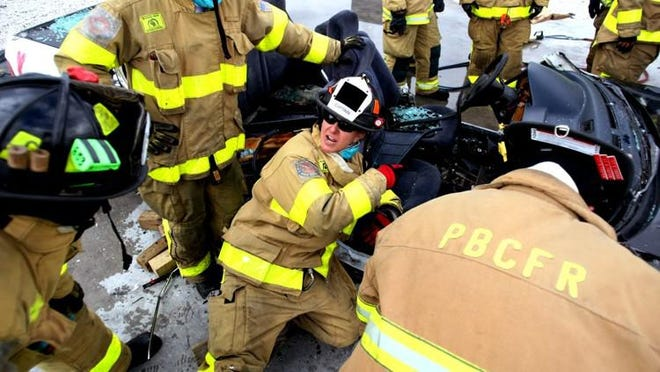 West Palm Beach Fire Rescue Chief Diana Matty on the job in 2012, teaching firefighters vehicle extrication.