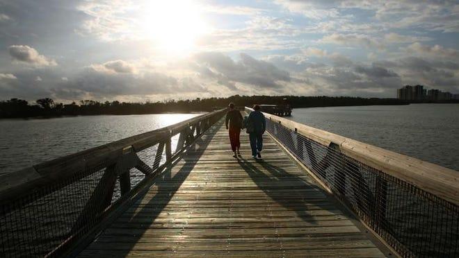 Allyson Ehrlich (left) of Brooklyn, N.Y. and her mother Diane Ehrlich of West Hampton Beach, N.Y. walk to the beach at John D. MacArthur Beach State Park.