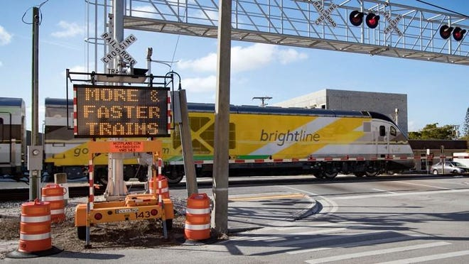 Brightline has placed electronic signs at some of the intersections of the FEC tracks. This sign on Lucerne in Lake Worth warns pedestrians to ?stay off train tracks? and that there are ?more & faster trains.?