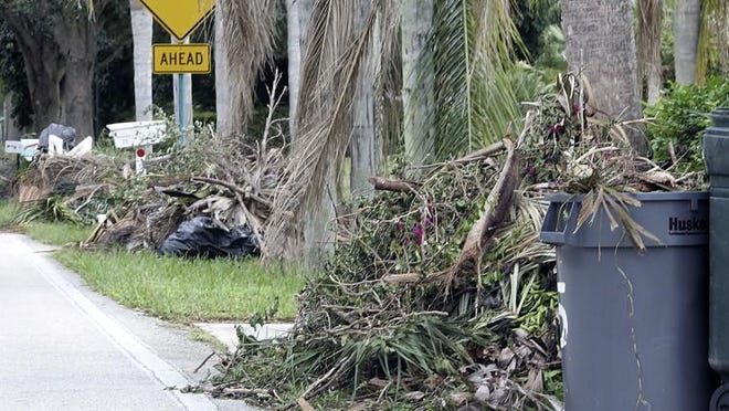 Residents along Country Club Drive in Tequesta pile debris in front of their homes for bulk pick up in October 2016 after Hurricane Matthew.