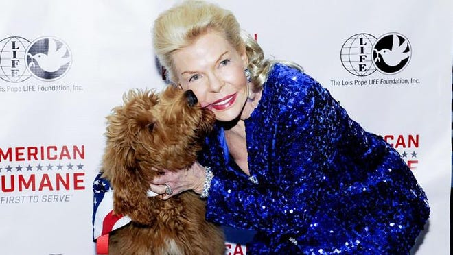 Lois Pope with Patton at American Humane Association ?Celebration of Military War Dogs? Reception on Feb. 9, 2017. Pope recently celebrated her birthday in Palm Beach.