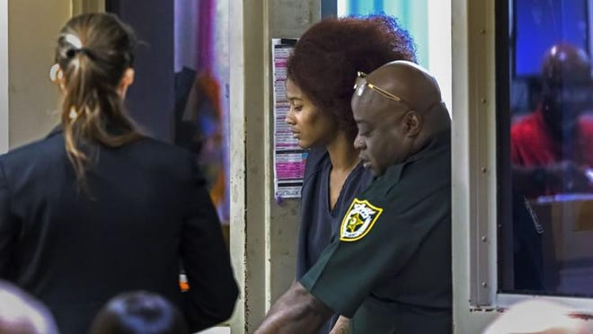 Barbara James-Tolbert enters court Thursday, September 13, 2018, charged with premeditated first degree murder.  James-Tolbert is accused of fatally shooting Albren Banks of West Palm Beach shortly before 3 p.m. Wednesday.  He died Wednesday evening.