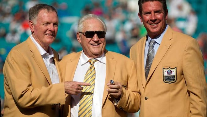 Former Miami Dolphins Hall of Fame quarterbacks Dan Griese and Dan Marino with head coach Don Shula who was honored at halftime with a Hall of Fame ring at Sun Life Stadium in Miami Gardens, Florida on November 22, 2015.