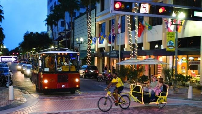 With downtown roads more and more jammed, West Palm Beach hopes more people will switch from cars to trolleys.