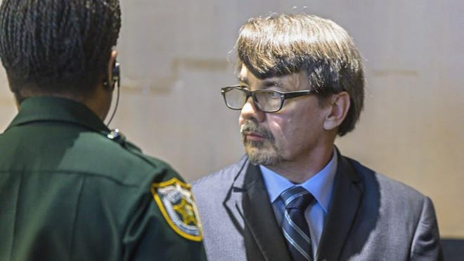 Gary Kitchings stands in court while the jury deliberated his fate Friday morning, March 16, 2018. The Uber driver was found guilty of three sexual battery charges Friday afternoon.