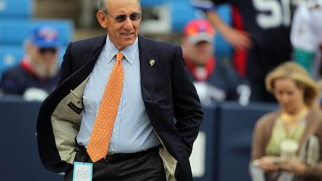 Miami Dolphins owner Stephen Ross walks onto the field before the season opener in Buffalo.