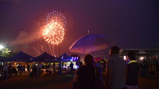 Rain couldn't keep thousands of people from heading to Wellington's Village Park on Wednesday for the village's annual Fourth of July celebration.