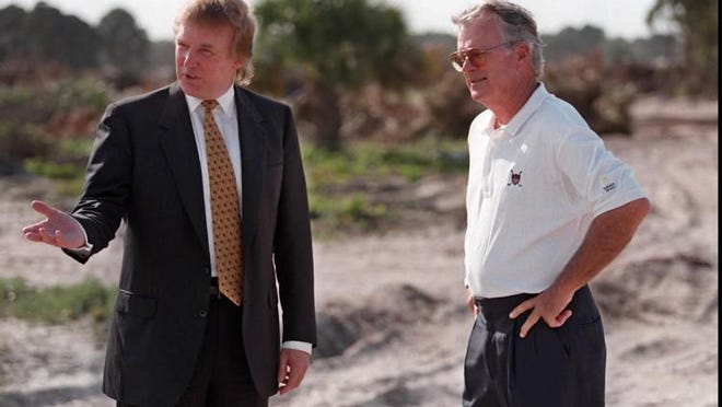 Donald Trump talks with Jim Fazio, who designed the golf course at Trump International Golf Club in West Palm Beach, as the course is under construction on April 3, 1998.