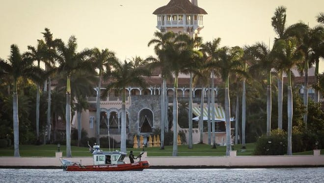A U.S. Coast Guard boat patrols the Intracoastal Waterway at Mar-a-Lago in Palm Beach after the  2016 presidential election.