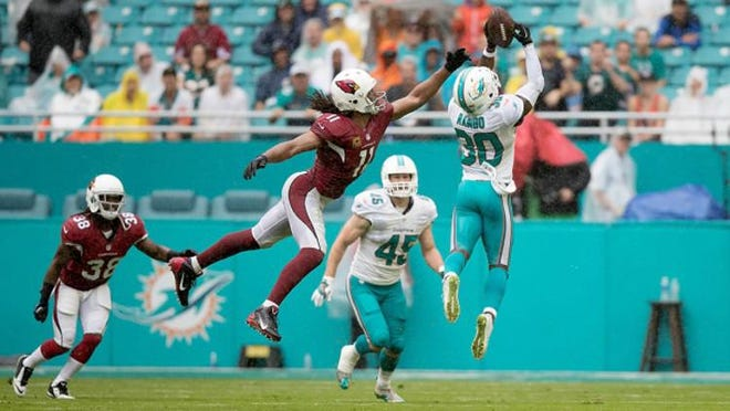 Dolphins safety Bacarri Rambo intercepts a pass intended for Arizona Cardinals receiver Larry Fitzgerald in 2016.