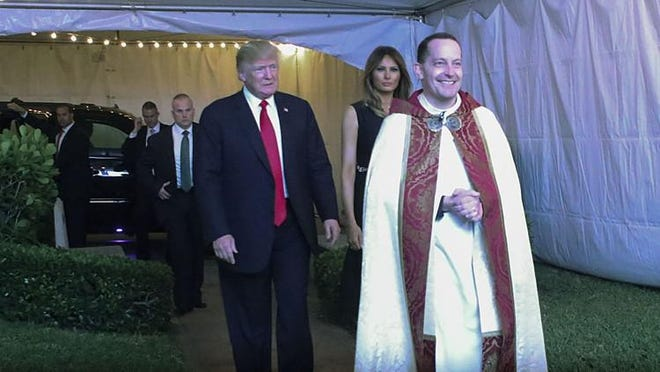 President Donald Trump and first lady Melania Trump are led into the Episcopal Church of Bethesda-by-the-Sea by the Rev. James Harlan for Christmas Eve services in 2017.