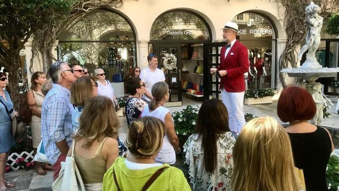 Rick Rose conducts a walking tour of Worth Avenue in 2019. Proceeds from the tours funded the Worth Avenue Association's gift to the Town of Palm Beach United Way.