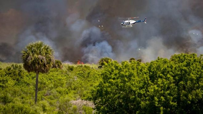 The Florida Forest Service uses a helicopter to drop slow burning devices to start a 5,000-acre controlled burn on the west side of Lake Okeechobee.