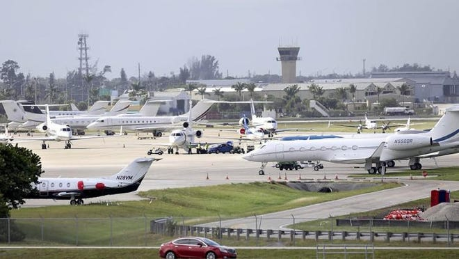 Executive jets parked at Palm Beach International Airport. About 40 percent of the traffic at PBIA is private planes.