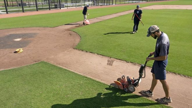 In this 2018 photo, Teddy Gutman edges the infield as groundskeepers work on one of the Washington Nationals practice fields at The Ballpark of the Palm Beaches in West Palm Beach.