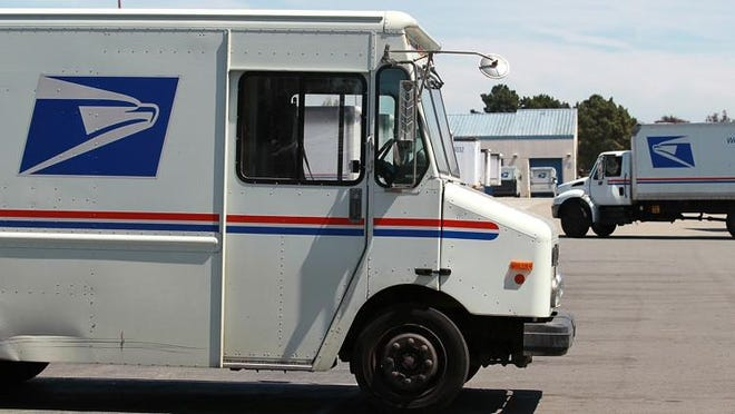 SAN FRANCISCO -- U.S. Postal Service trucks are seen parked near the loading dock at the U.S. Post Office sort center here on August 12.