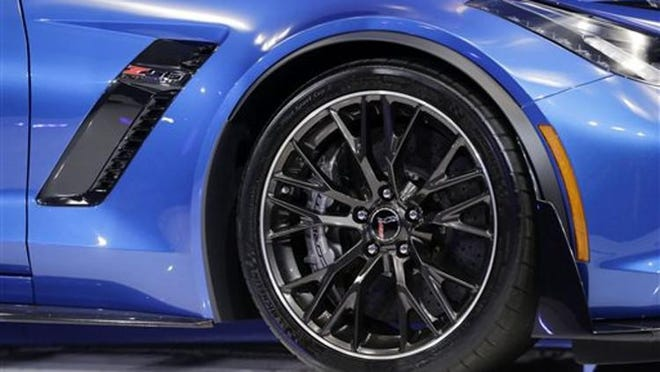 The front tire of a Chevrolet 2015 Corvette Z06 convertible is shown at the New York International Auto Show, Tuesday, April 15, 2014 in New York.