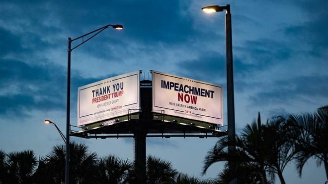 Competing opinions come into view while driving past the billboards at the intersection of I-95 and Southern Boulevard in West Palm Beach. The Committee to Defend the President, a political action committee that counters attacks on the president, installed the THANK YOU billboard after learning that Mad Dog PAC, an anti-Trump political action committee, had installed an impeachment billboard along the president? motorcade route.