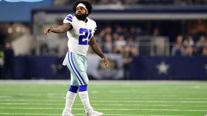 Dallas Cowboys running back Ezekiel Elliott said his symptoms were mild when he was diagnosed with COVID-19 in June. He had a cough, shortness of breath and heavy breathing for two days, but says he didn't work out for a month to be cautious.