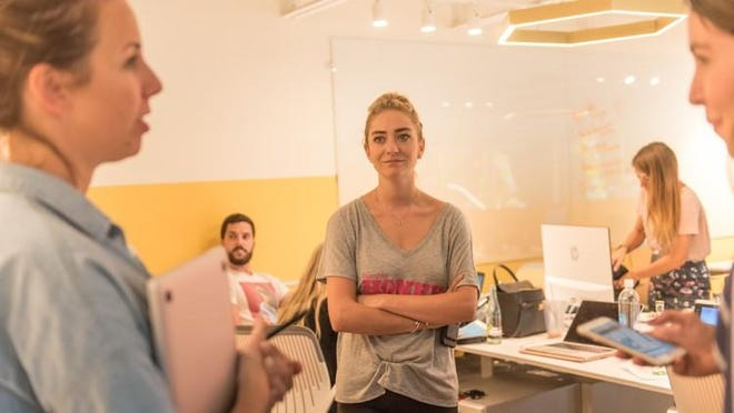 Whitney Wolfe Herd, center, founded Bumble in 2014. The business started as a dating app before expanding into a women-centric social networking platform.