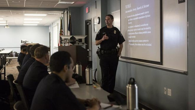 Michael Baker, senior police officer for the Austin Police Department, teaches cadets about arrest, search and seizure at the Roy Butler academy in 2018.